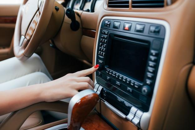 Girl hand on car dashboard