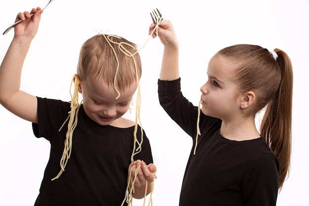 The girl hangs noodles on the ears