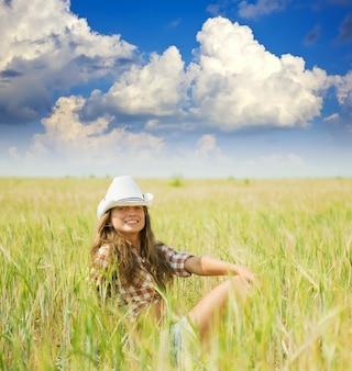 Girl  in hat at  field