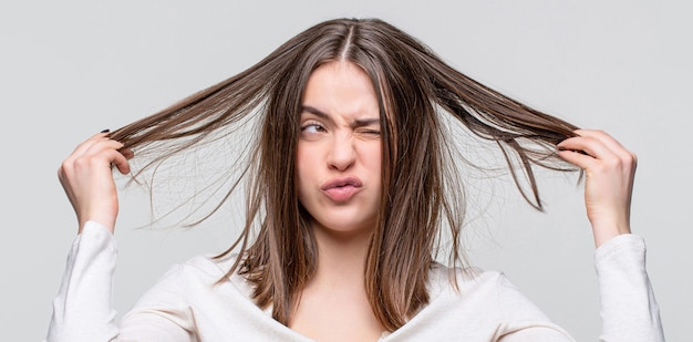 Girl having a bad hair. bad hairs day. frustrated woman having a bad hair. woman having a bad hair, her hair is messy and tangled