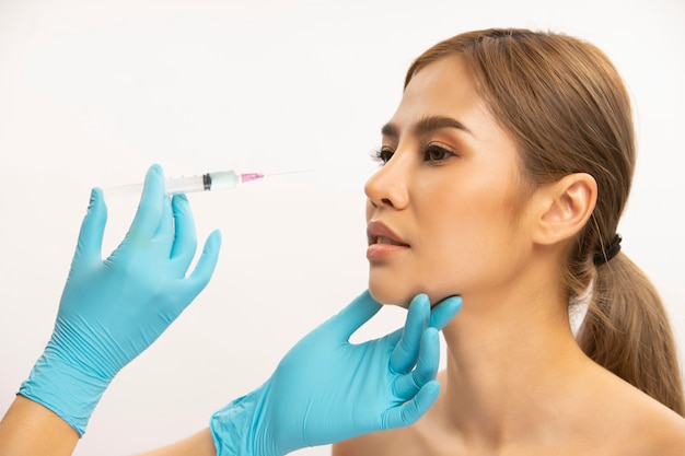 Girl having a botox injection for fuller lips