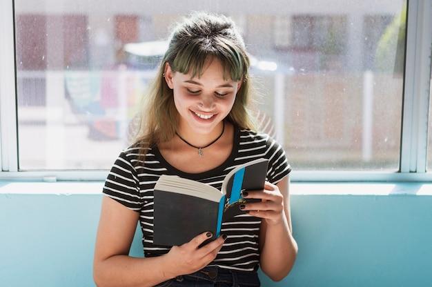 Girl having fun reading a book