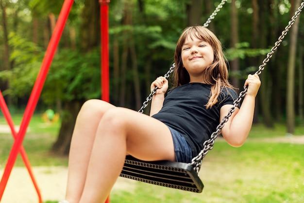 Girl having fun on swing