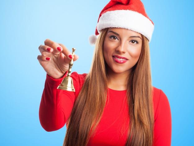 Girl having fun with a handbell