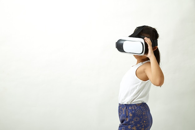 Girl having fun with virtual reality headset