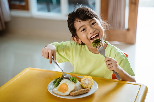 Girl having healthy breakfast at home