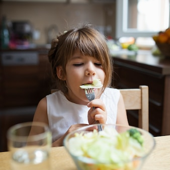 Girl having healthy meal at home