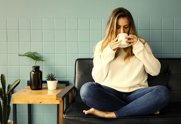 Girl having a hot cup of coffee