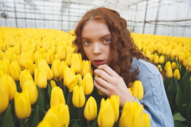 Girl hiding in flowers
