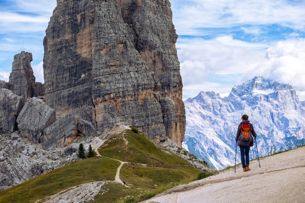 Girl hiker at the mountains dolomites, italy. cinque torri