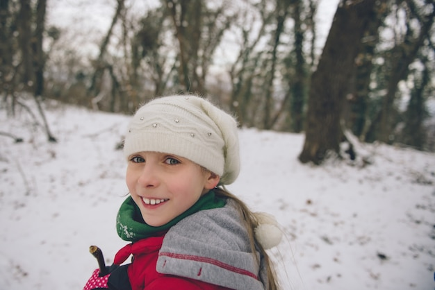 Girl hiking in the white winter forest