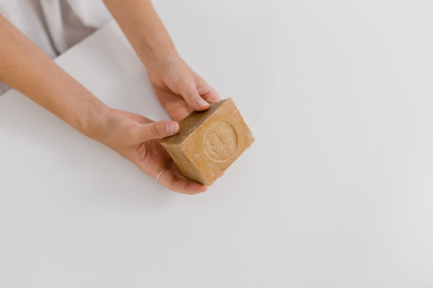 Girl hold a natural soap