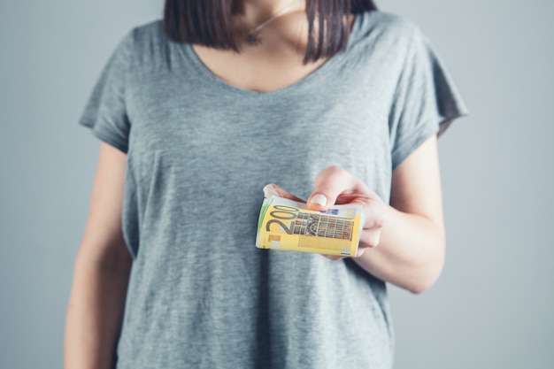 Girl holding big money in her hands