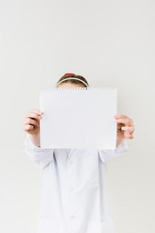 Girl holding blank paper sheet