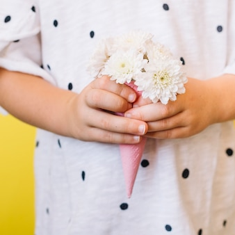Girl holding bouquet in cone