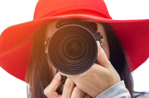 Girl holding camera.
