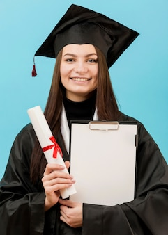 Girl holding clipboard and diploma