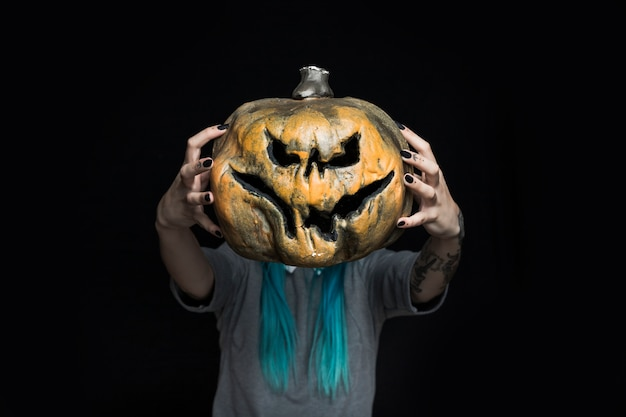 Girl holding creepy pumpkin