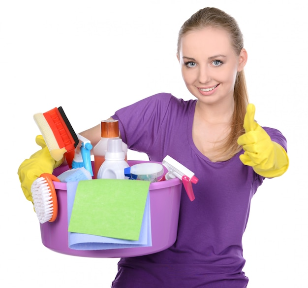 Girl holding detergent and showing thumbs up.