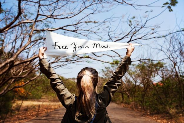 Girl holding free your mind flag banner