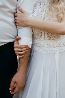 Girl holding a guy's hand. boho style