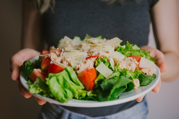 Girl holding healthy salad ready to eat