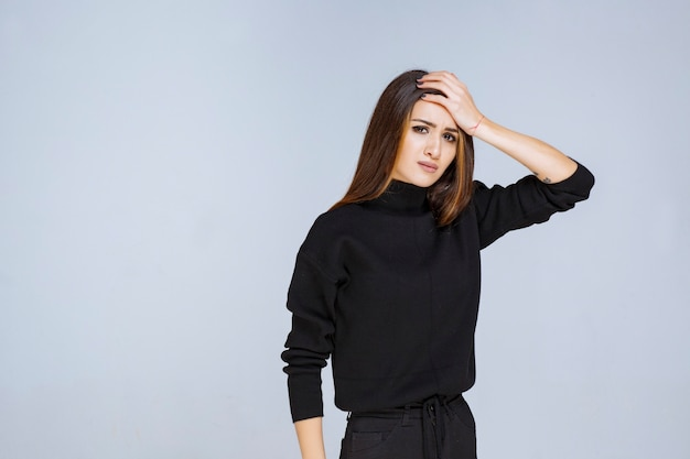 Girl holding her head as she is tired or has headache. high quality photo