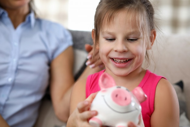 Girl holding money box
