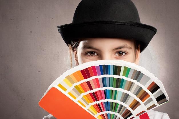 Girl holding a pantone palette