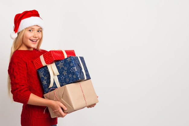Girl holding pile of presents