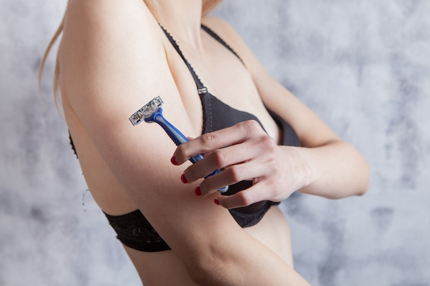 Girl holding a razor in her hand