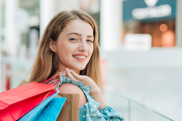 Girl holding shopping bags close up