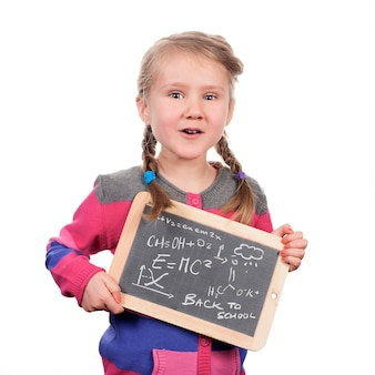Girl holding slate on white space