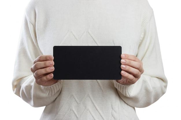 Girl holding an small blackboard