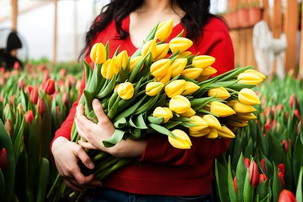 Girl holding tulips