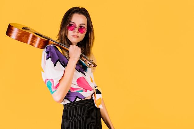 Girl holding an ukelele