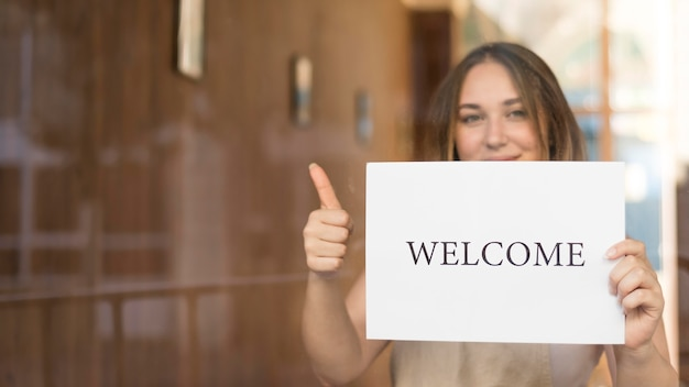 Girl holding a welcome sign after the end of quarantine