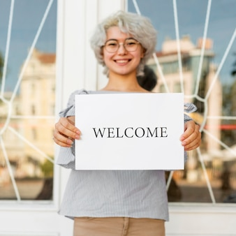 Girl holding a welcome sign