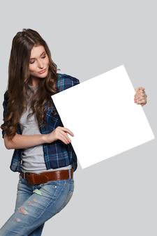 Girl holding white billboard