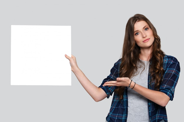 Girl holding white billboard