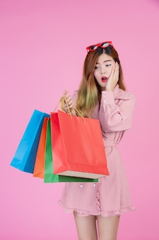 The girl holds a fashion shopping bag and beauty