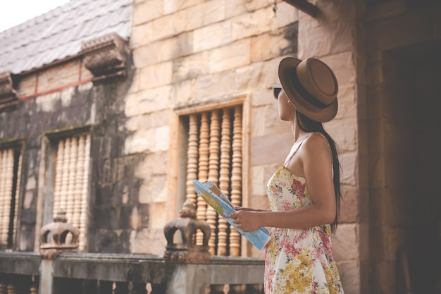 Girl holds a tourist map in the old town.