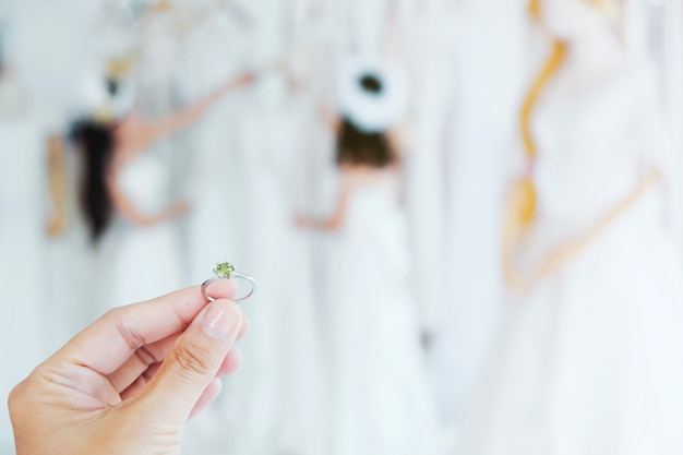The girl holds the wedding ring.