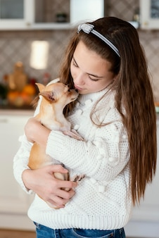 Girl at home with dog