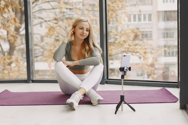 Girl at home. woman make yoga. lady shoot a video blog.