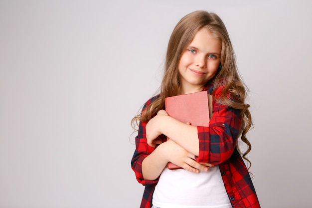 Girl hugging book