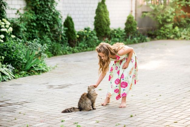 Girl hugging her dog wearing beautiful dress with a dog