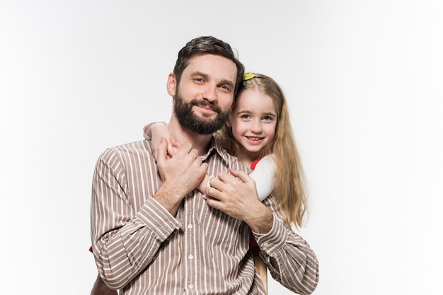 Girl hugging her father over a white