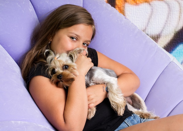 Girl hugging a yorkshire terrier