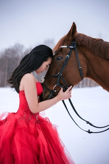 Girl hugs horse, girl in red dress, horse, asian